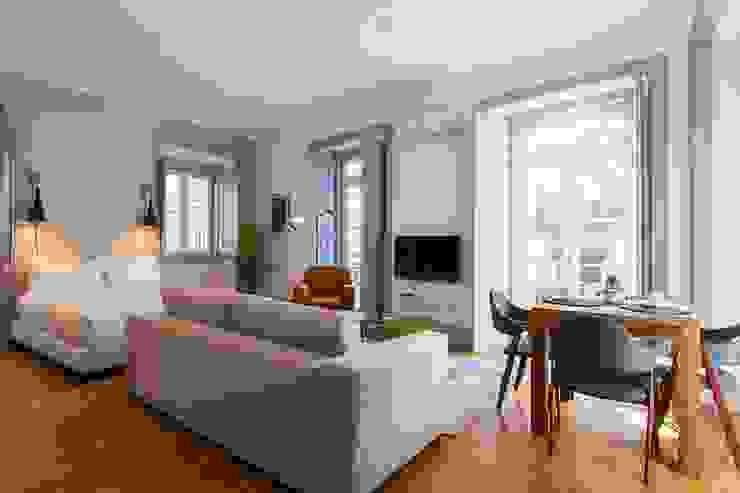 OpenSpace - Zona da sala de estar por Traço Magenta - Design de Interiores Moderno