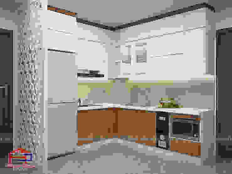 Ảnh thiết kế 3D tủ bếp acrylic kết hợp laminate và vách ngăn CNC nhà Mrs.Huyền ở Hoàng Cầu: hiện đại  by Nội thất Hpro, Hiện đại