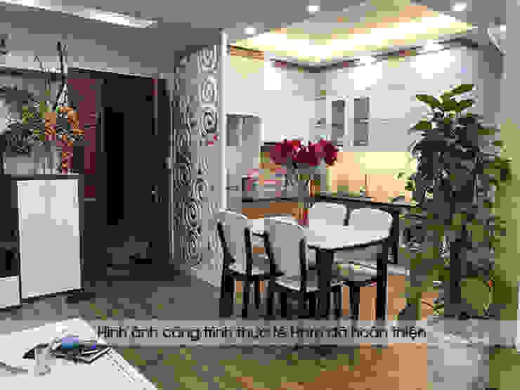 Hình ảnh thực tế tủ bếp acrylic kết hợp laminate kèm vách ngăn CNC nhà Mrs.Huyền ở Hoàng Cầu: hiện đại  by Nội thất Hpro, Hiện đại