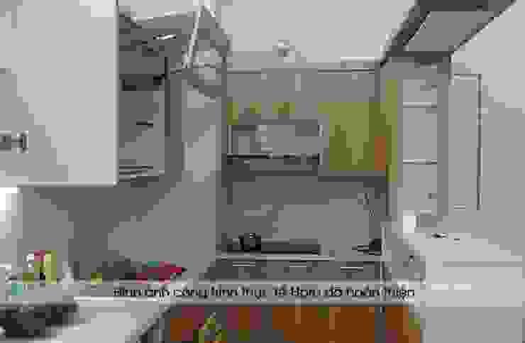 Hình ảnh bên trong hệ tủ bếp laminate kèm quầy bar nhà anh Lộc ở Cầu Giấy: hiện đại  by Nội thất Hpro, Hiện đại