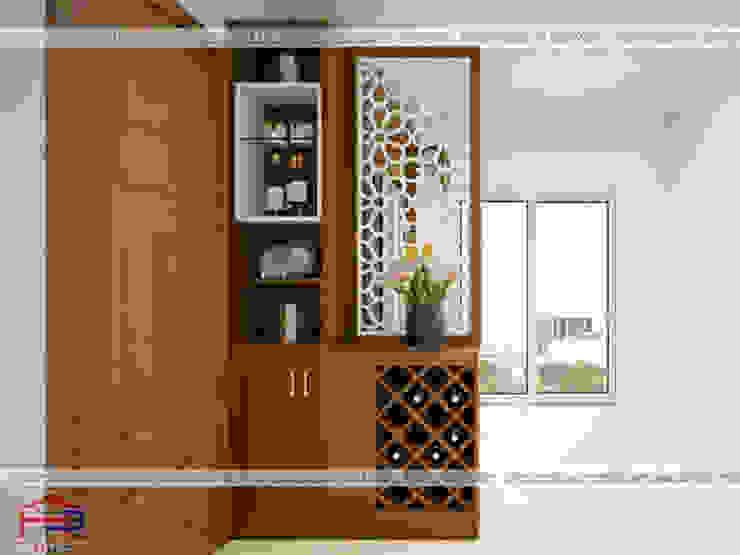 Ảnh thiết kế tủ bếp gỗ sồi mỹ kèm vách ngăn nhà bác Khôi ở Hoàng Cầu bởi Nội thất Hpro