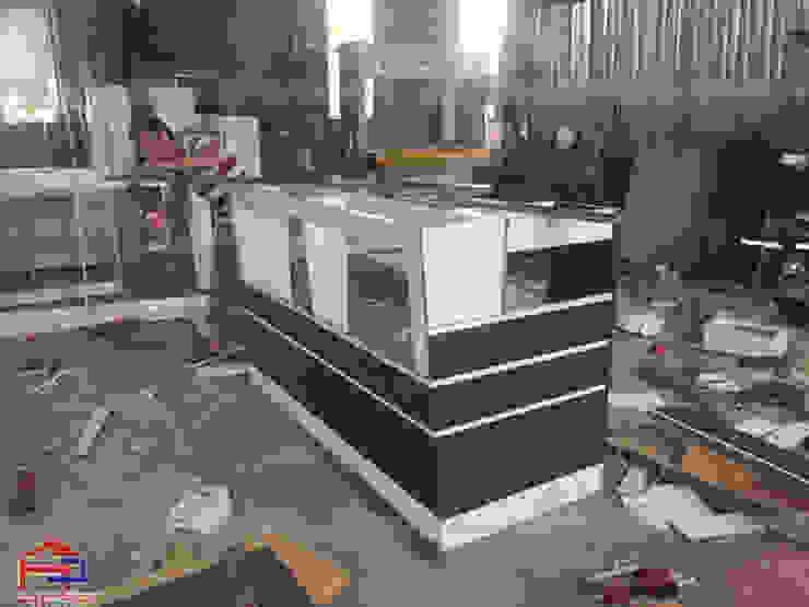 Hình ảnh thi công nội thất gỗ laminate tại xưởng của Hpro cho nhà hàng Buffet Poseidon- 85 Lê Văn Lương: hiện đại  by Nội thất Hpro, Hiện đại
