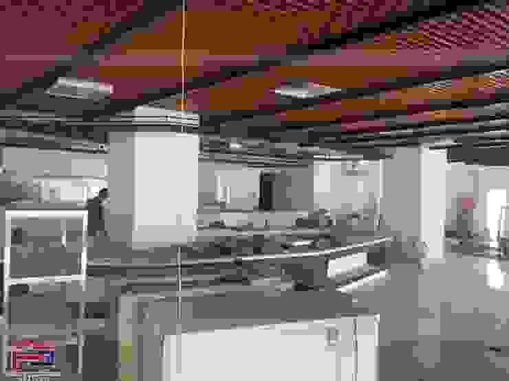 Hình ảnh thi công thực tế nội thất gỗ laminate tại nhà hàng Buffet Poseidon- 85 Lê Văn Lương: hiện đại  by Nội thất Hpro, Hiện đại