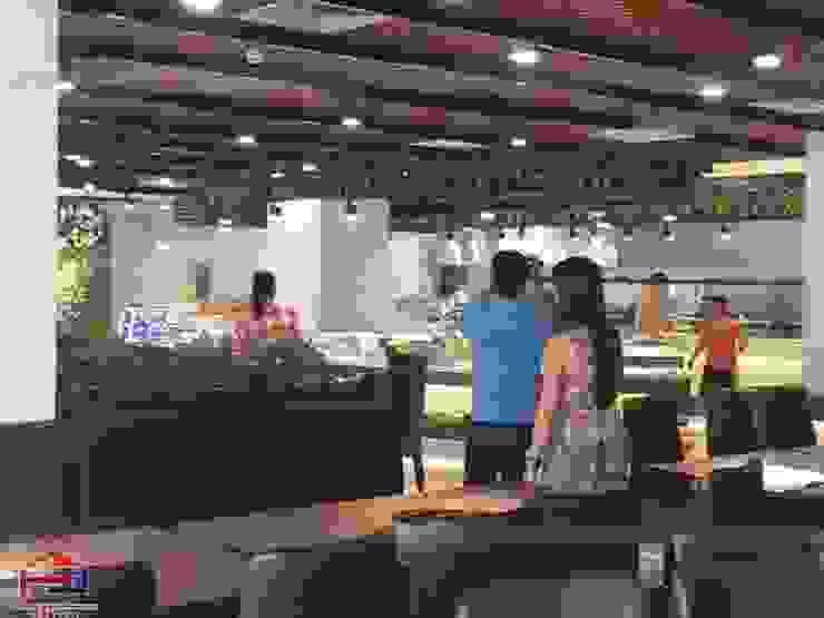 Hpro hoàn thiện công trình nội thất gỗ laminate cho nhà hàng Buffet Poseidon- 85 Lê Văn Lương: hiện đại  by Nội thất Hpro, Hiện đại