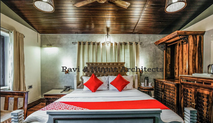 Completed Project-Hotel Agroha ,Mount Abu #a colonial era bungalow tastefully transformed to a boutique hotel with all modern luxuries and amenities #design creation @Ravi & NupurArchitects by RAVI - NUPUR ARCHITECTS Colonial Wood Wood effect
