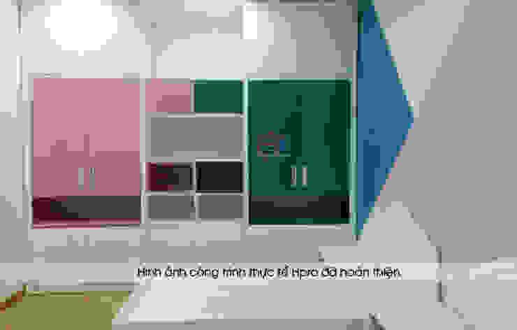 Ảnh thực tế tủ quần áo melamine trong nội thất phòng ngủ của bé nhà chị Hương ở Sơn La: hiện đại  by Nội thất Hpro, Hiện đại