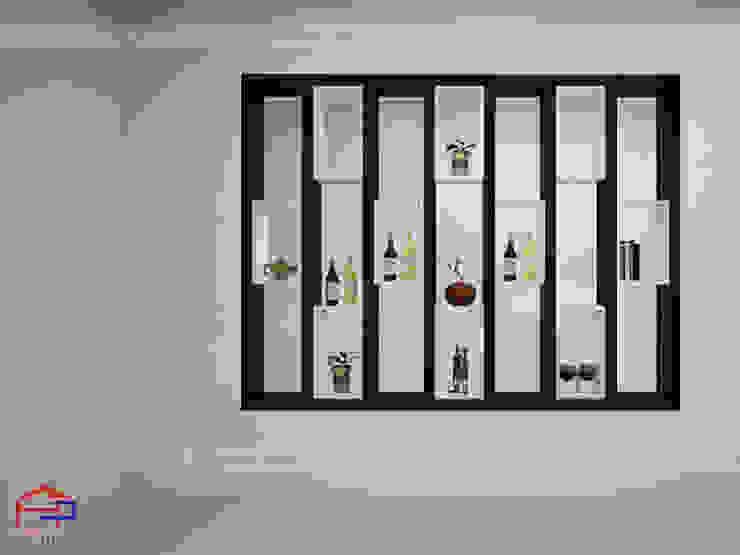 Thiết kế vách ngăn phòng khách gỗ melamine 2 nhà anh Thủy ở Hải Phòng: hiện đại  by Nội thất Hpro, Hiện đại