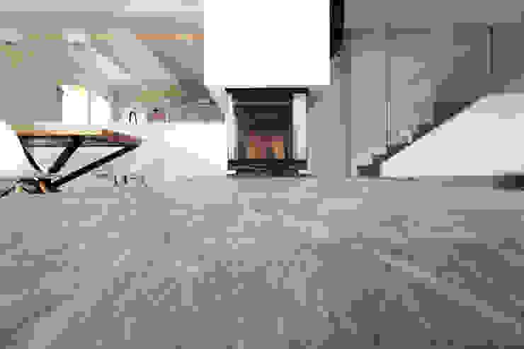 Flavia Benigni Architetto Salas de estilo moderno Piedra Gris
