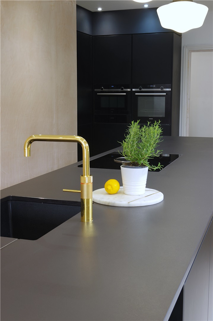 Matte Black kitchen with limited edition golden tap by Quooker Modern style kitchen by PTC Kitchens Modern