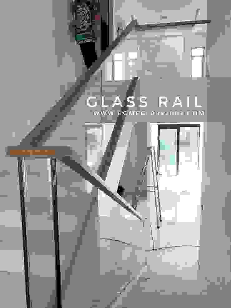 ราวบันได กระจกเปลือย กระจกเทมเปอร์/ลามิเนต หนา 8 มม+8มม ราวมือจับไม้: ทันสมัย  โดย Home Glass 2003, โมเดิร์น กระจกและแก้ว
