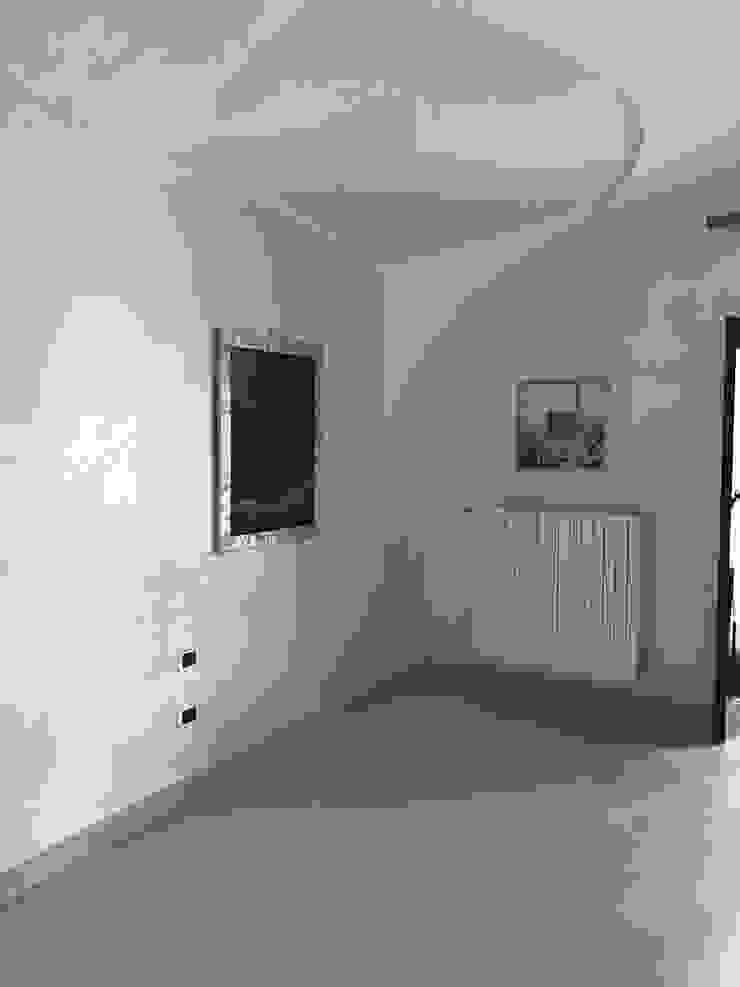 STUDIO ARCHITETTURA SPINONI ROBERTO Rustic style walls & floors