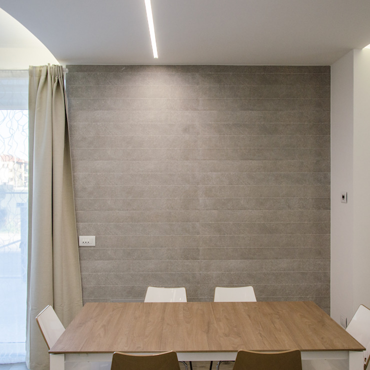 Paredes y pisos de estilo moderno de Studio ARCH+D Moderno Cerámico