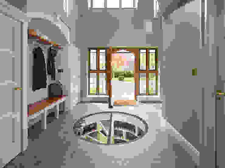 White Spiral Cellar with hinged round glass door Nowoczesna piwnica win od Spiral Cellars Nowoczesny