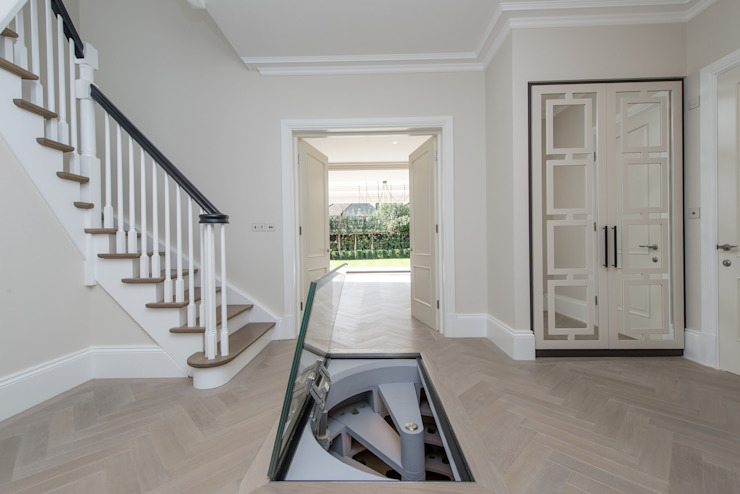 White Spiral Cellar with Rectangular glass door Nowoczesna piwnica win od Spiral Cellars Nowoczesny