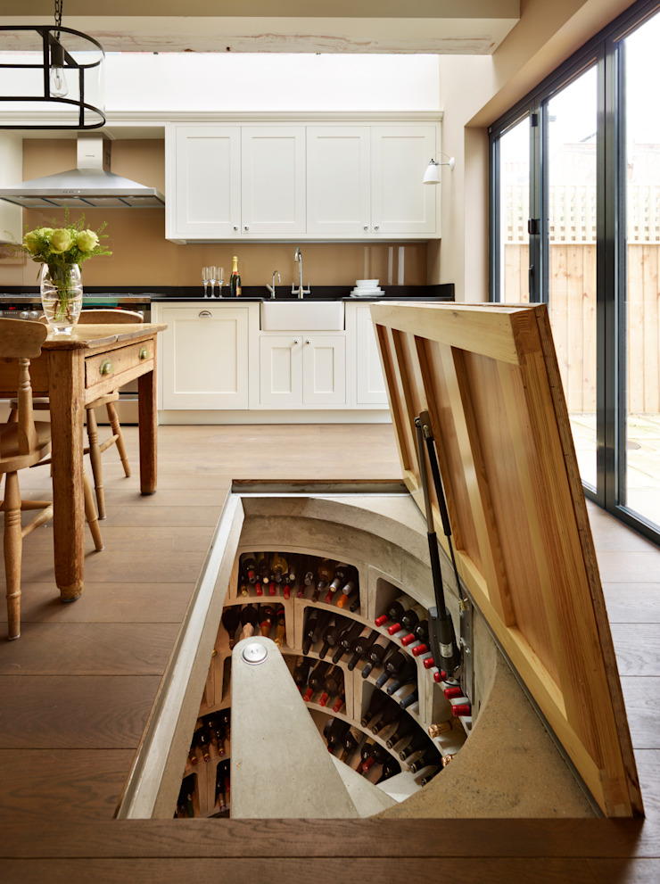 Original Spiral Cellar with concealed timber door Rustic style wine cellar by Spiral Cellars Rustic