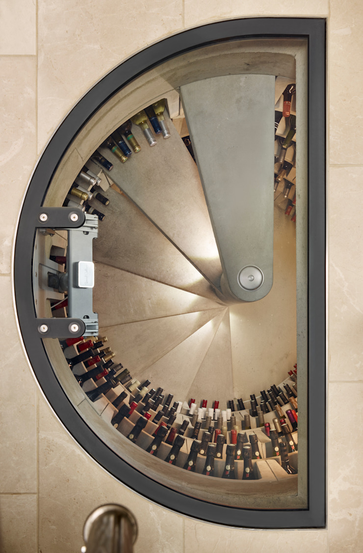 Top shot of Half round glass door Rustic style wine cellar by Spiral Cellars Rustic