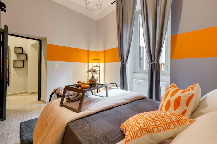 Appartamento adibito a casa vacanza Creattiva Home ReDesigner - Consulente d'immagine immobiliare Camera da letto in stile industriale