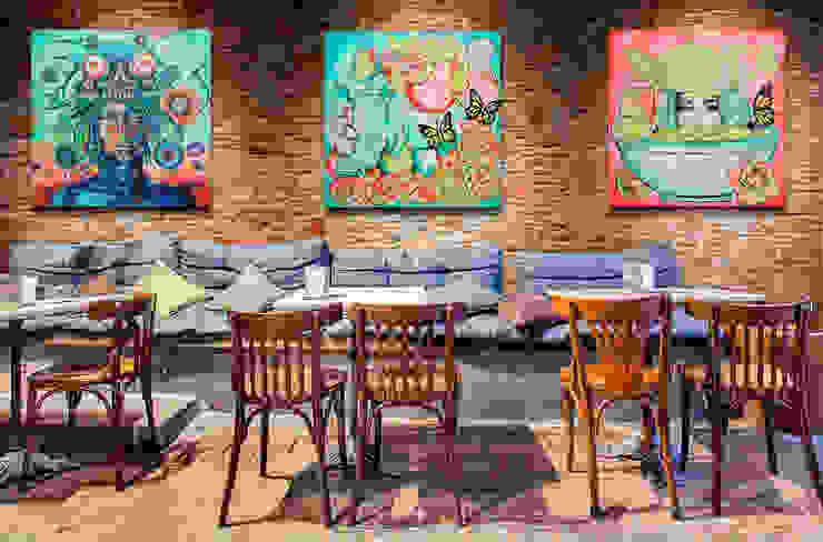 Decoración con arte en restaurante informal Gastronomía de estilo moderno de Arca México Moderno