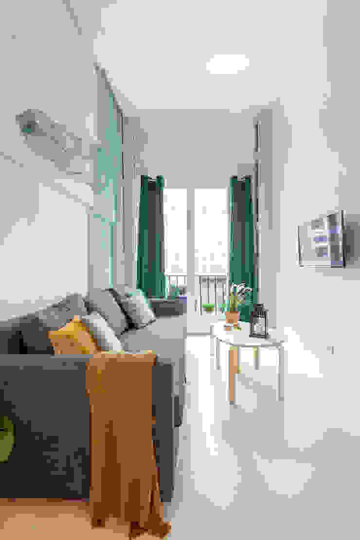Apartamento en Gran Vía. Madrid Salones de estilo ecléctico de Estudio Mercedes Arce Ecléctico Cobre/Bronce/Latón