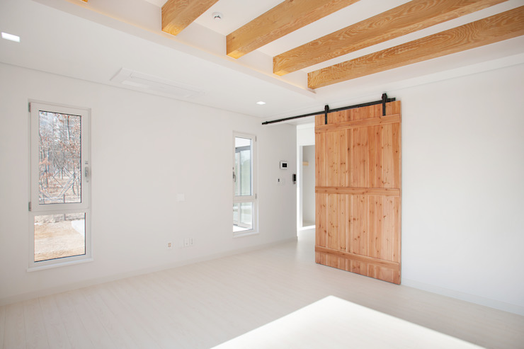 Modern Living Room by 반디건축디자인 Modern