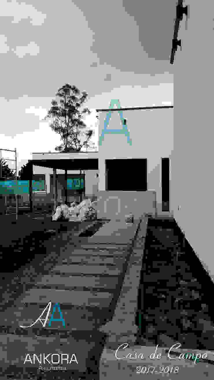 acceso principal de ANKORA ARQUITECTOS Moderno Concreto