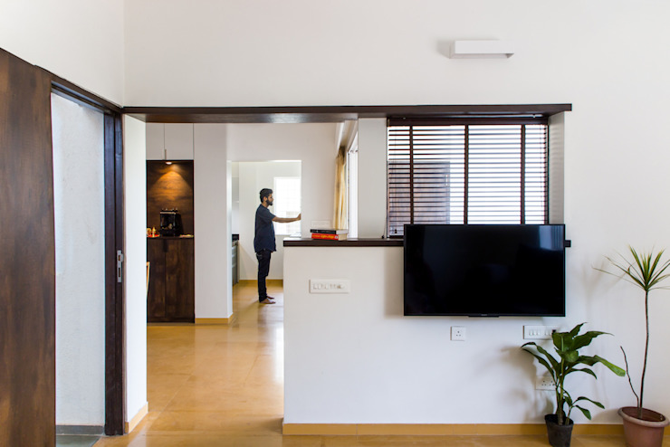 View to dining, kitchen and terrace from Living room Modern Living Room by M+P Architects Collaborative Modern