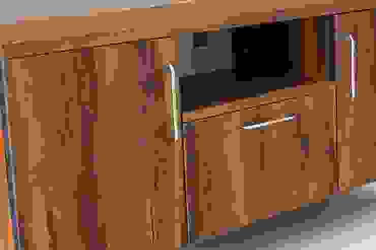 TV unit:  Living room by Enrich Interiors & Decors,Rustic