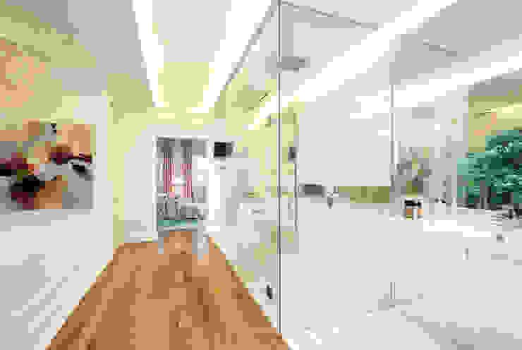White Bathroom Design by Design Intervention Modern bathroom by Design Intervention Modern