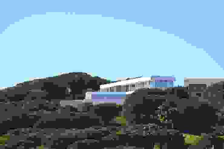 Emplazamiento Casas modernas: Ideas, imágenes y decoración de ARKUM Moderno