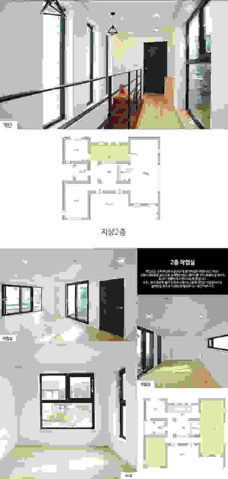 Salas de entretenimiento de estilo moderno de 한글주택(주) Moderno