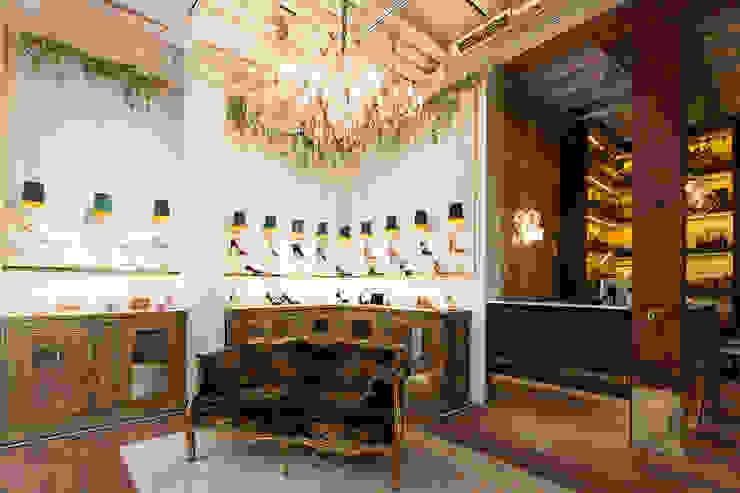 Pared de ladrillo y neón Oficinas y tiendas de estilo ecléctico de Interioristas Dimeic, diseñadores y decoradores en Madrid Ecléctico