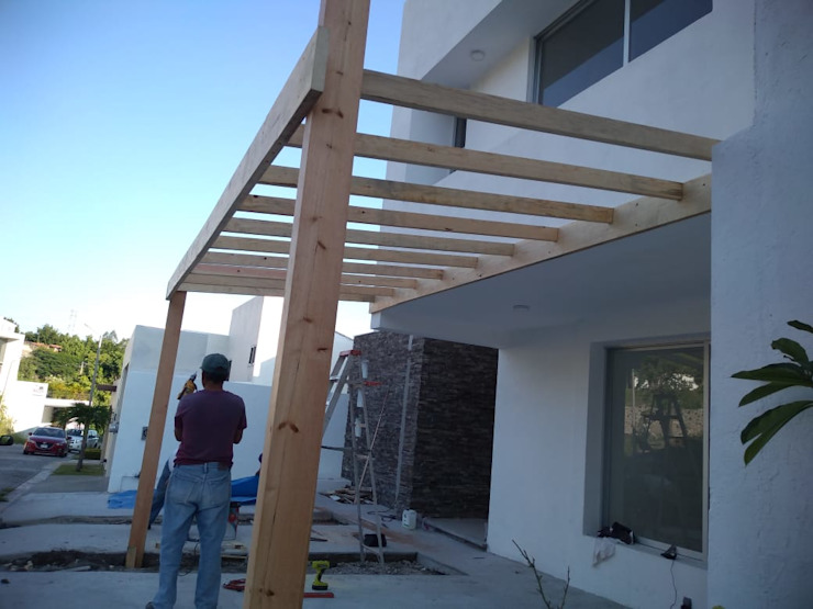 Casas estilo moderno: ideas, arquitectura e imágenes de Construcciones La Danta SA De CV Moderno