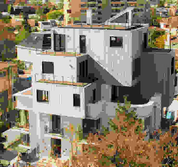 Edificio con Fachada transventilada Casas estilo moderno: ideas, arquitectura e imágenes de INFINISKI Moderno
