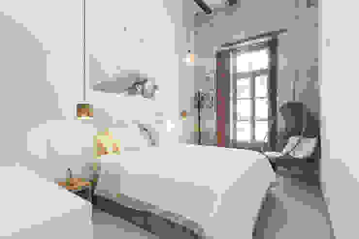 Suite principal Tilaq Estudio Dormitorios de estilo rústico Ladrillos