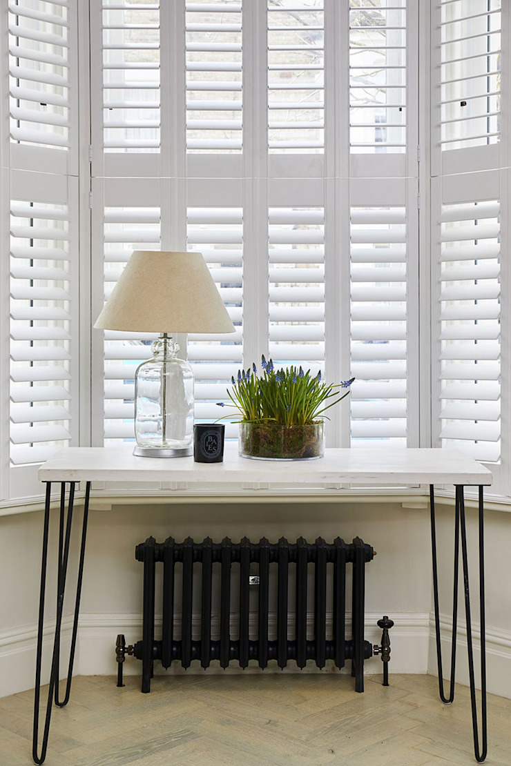 A Stunning Scandi Style Home in Fulham Plantation Shutters Ltd Scandinavian style living room MDF White