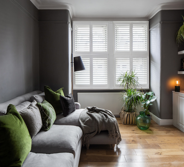 A Modish home in Southfields Plantation Shutters Ltd Modern living room Solid Wood White