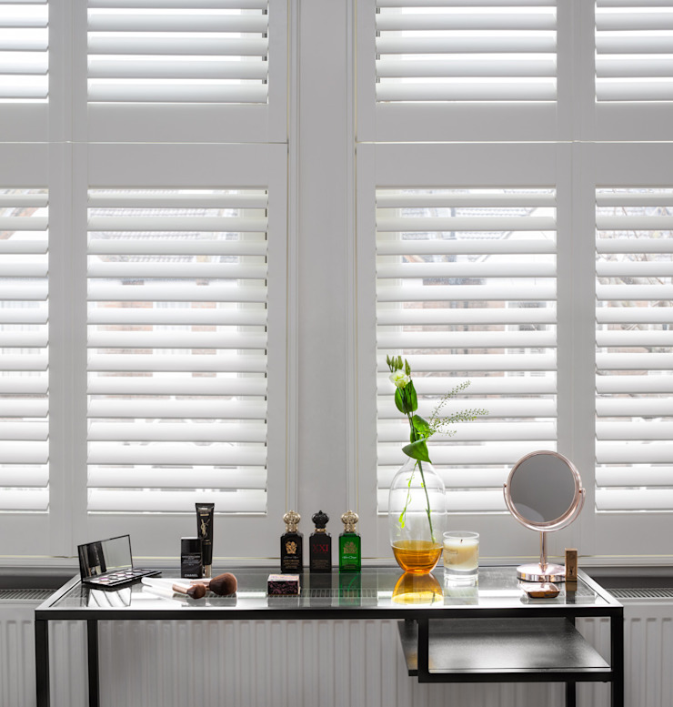 A Modish home in Southfields Plantation Shutters Ltd Modern dressing room Solid Wood White