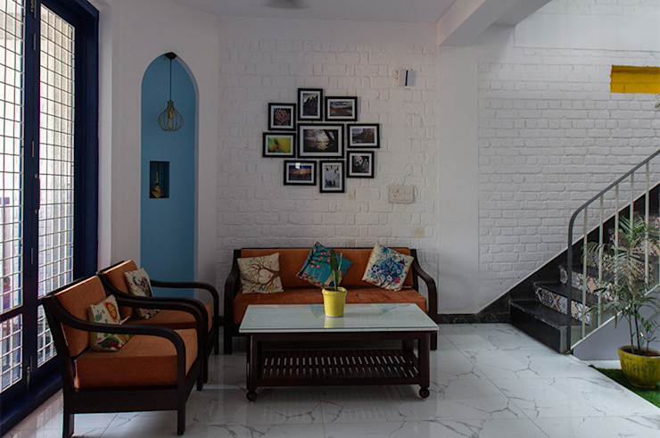 formal living space with pastel blue mihrab wall temple, filled with light Modern Living Room by Habitat Design Collective (Hdeco) Modern