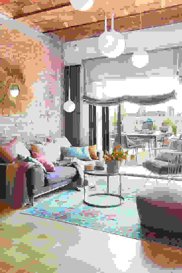 Modern Living Room by Xmas Arquitectura e Interiorismo para reformas y nueva construcción en Barcelona Modern Bricks
