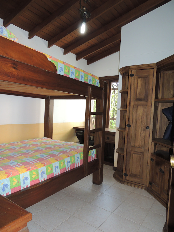 CIENTO ONCE INMOBILIARIA Rustic style bedroom