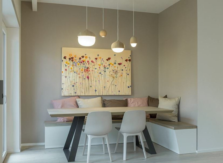 Dining with hanging lights and benches Modern dining room by decormyplace Modern Plywood