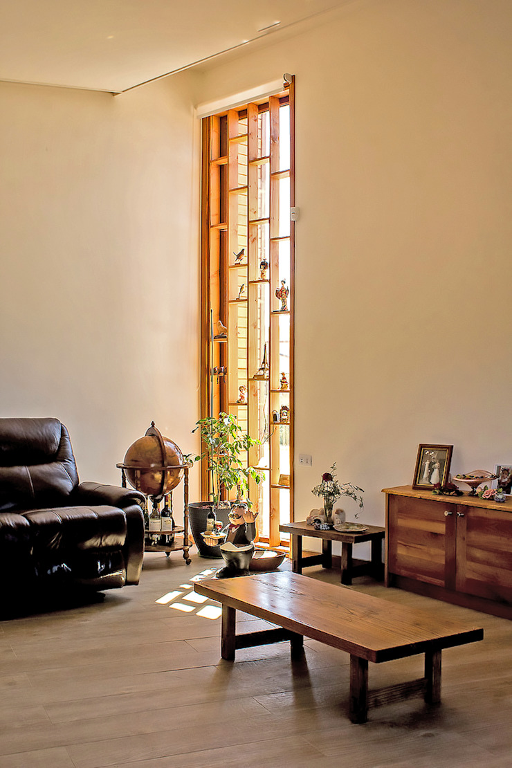 Living Livings de estilo rústico de Intermedio Arquitectos Rústico