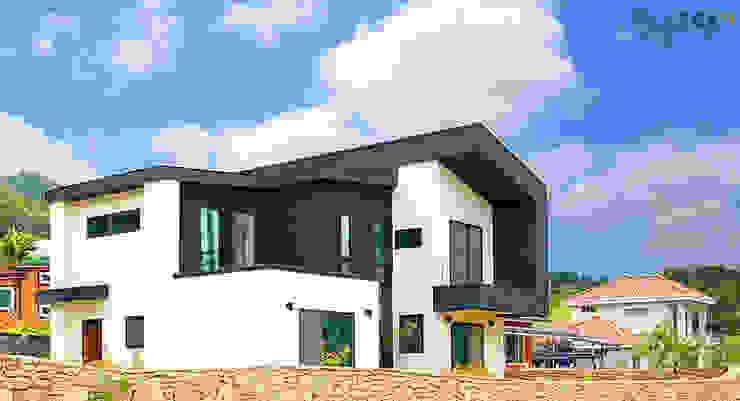 입체적인 전원주택 외관이 돋보이는 주택 모던스타일 주택 by 한글주택(주) 모던