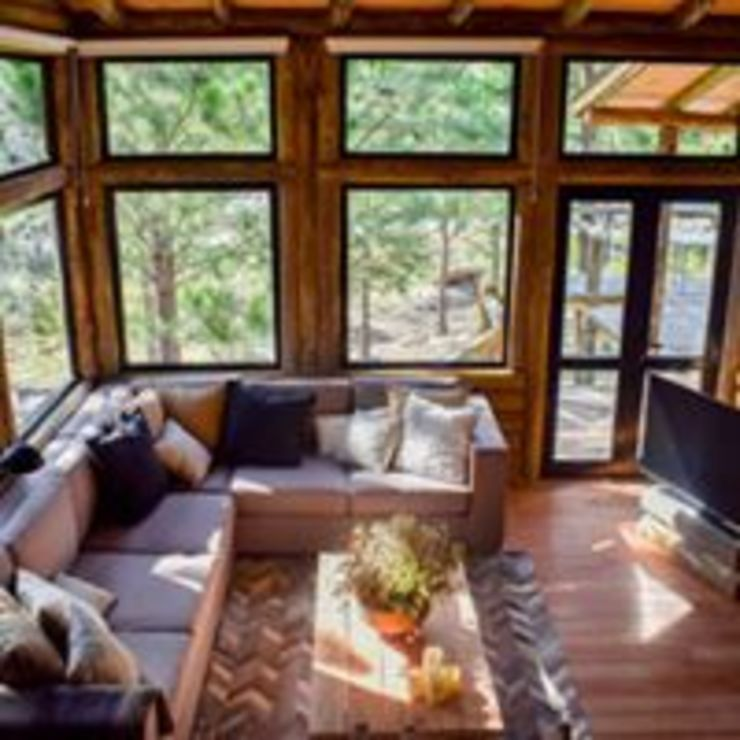 Construcciones de cabañas en tronco Hoteles de estilo rústico de Constructora Belaver Rústico