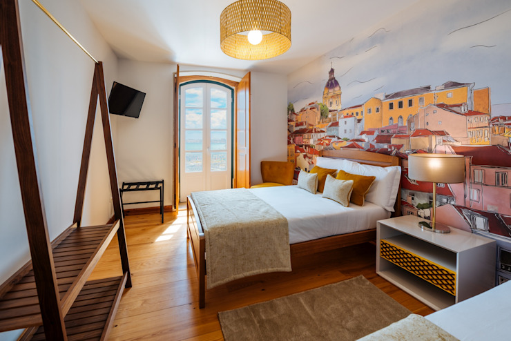 Alfama - Casa Amarela, Lisboa por EMME Atelier de Interiores