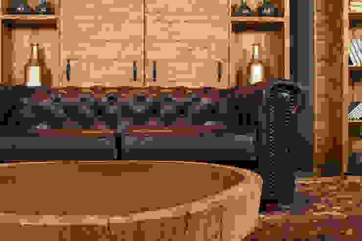 Sala Chesterfield Cognac: Salas de estilo  por Casa de las Lomas,