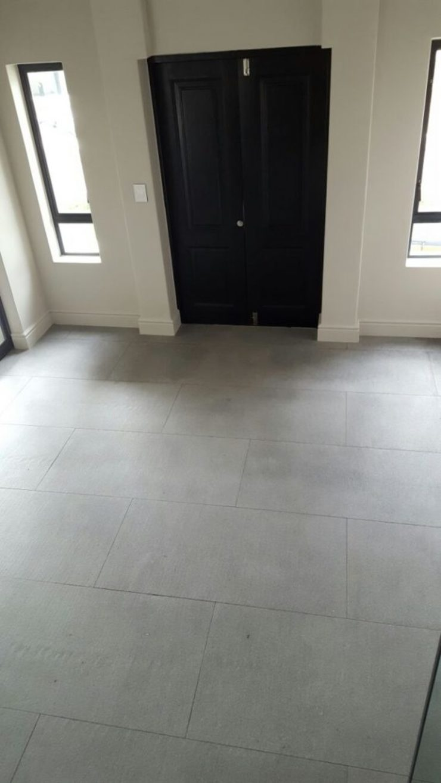 Misty Grey Granite Modern dining room by Persian Tiles Modern Tiles