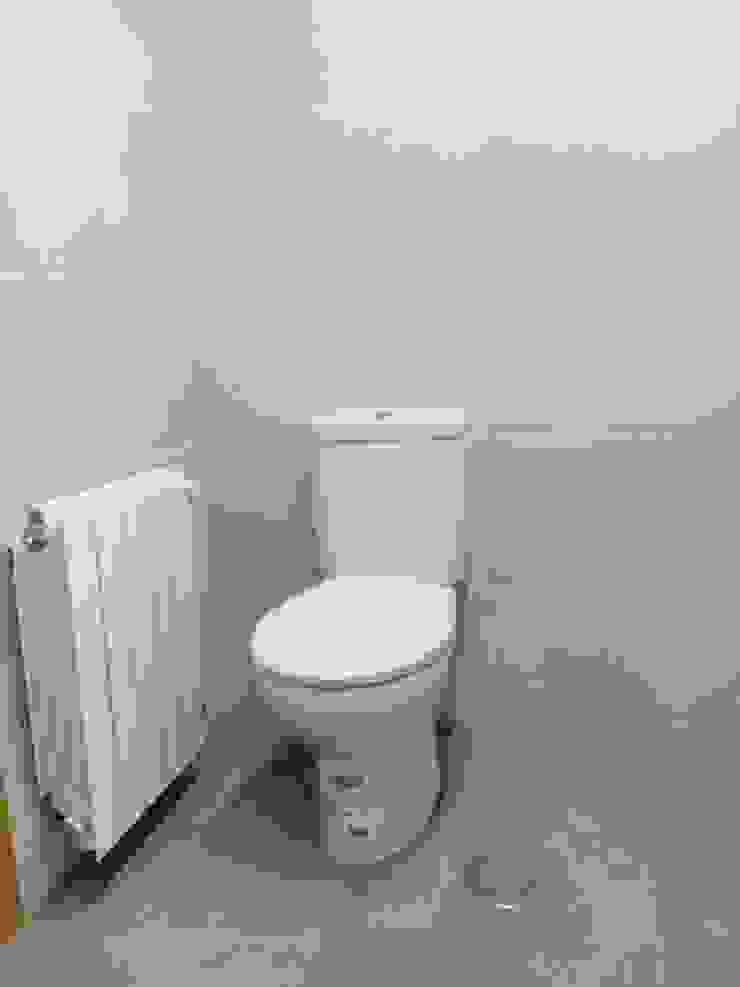 wc y radiador de Obrisa Reformas y rehabilitaciones. Moderno