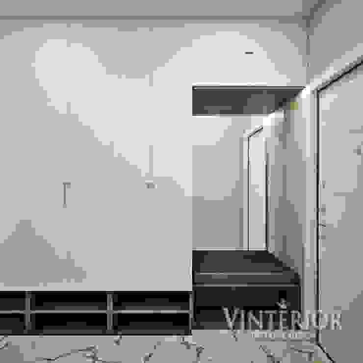 Small and cozy white and grey flat for young woman Puertas modernas de Vinterior - дизайн интерьера Moderno