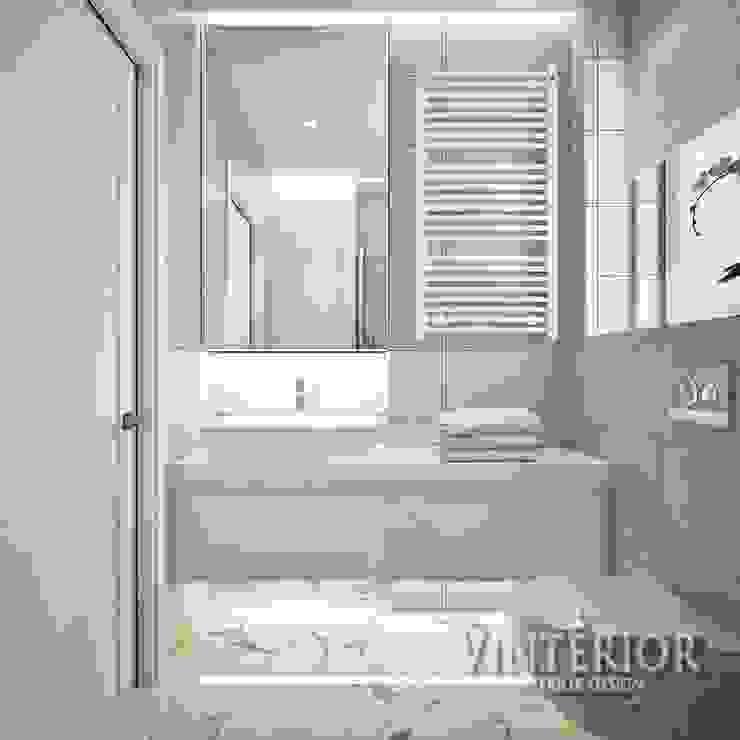 Small and cozy white and grey flat for young woman Baños de estilo moderno de Vinterior - дизайн интерьера Moderno